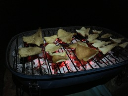 Tawny funnels on a barbecue.